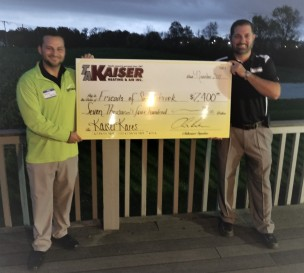 Saddlebrook Golf Club GM Jackson Krauter and Chris Kaiser pose with the big check from TA Kaiser.
